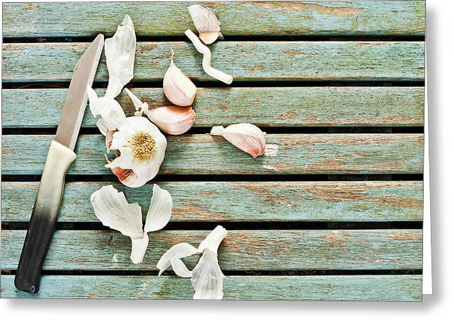 Background Greeting Cards - Cutting garlic Greeting Card by Tom Gowanlock