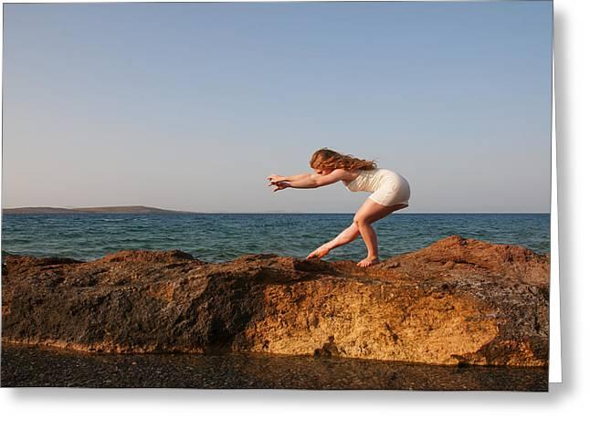 Model On Beach Greeting Cards - Dancing on the rocks Greeting Card by Manolis Tsantakis