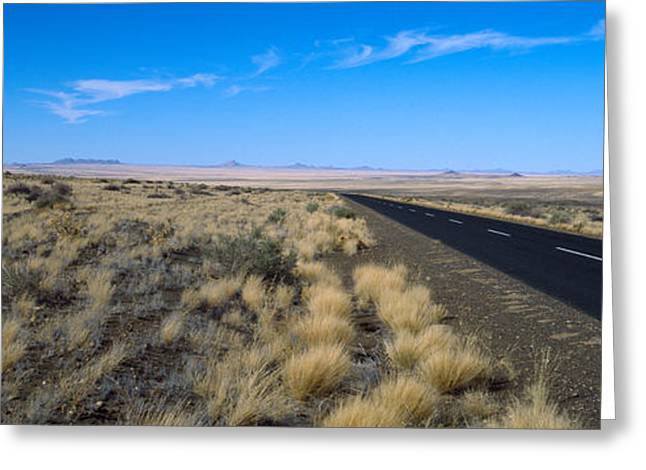 Wide Open Space Greeting Cards - Desert Road Passing Greeting Card by Panoramic Images