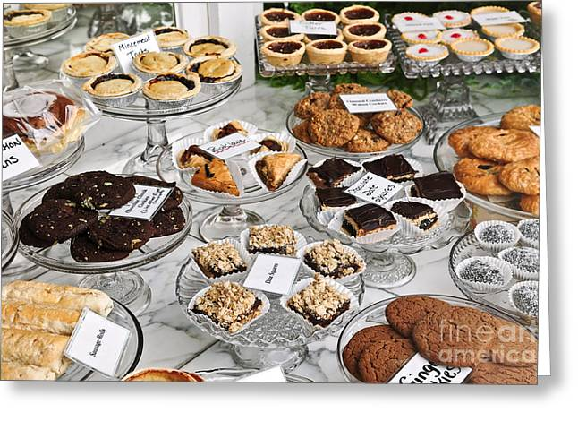 Dessert Photographs Greeting Cards - Desserts in bakery window Greeting Card by Elena Elisseeva