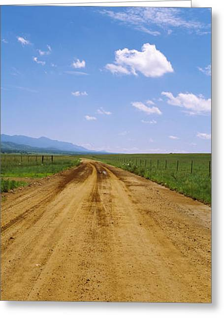San Rafael Greeting Cards - Dirt Road Passing Through A Landscape Greeting Card by Panoramic Images