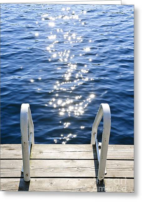 Inviting Greeting Cards - Dock on summer lake with sparkling water Greeting Card by Elena Elisseeva