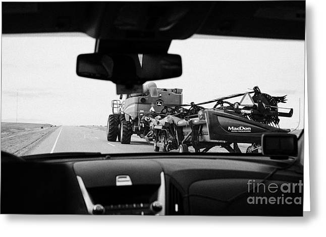 Driving Greeting Cards - driving behind combine harvester on road in Saskatchewan Canada Greeting Card by Joe Fox