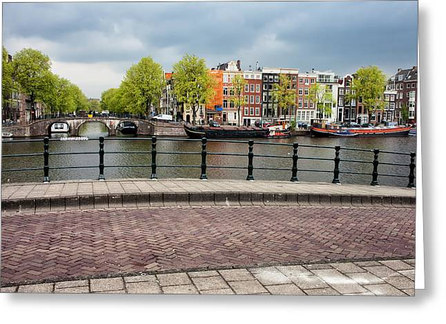 Old Home Place Greeting Cards - Dutch Houses by the Amstel River in Amsterdam Greeting Card by Artur Bogacki