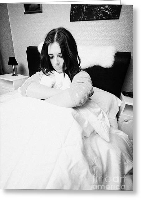 Woman Curled Position Greeting Cards - Early Twenties Woman Holding Duvet Tightly In Bed In A Bedroom Greeting Card by Joe Fox