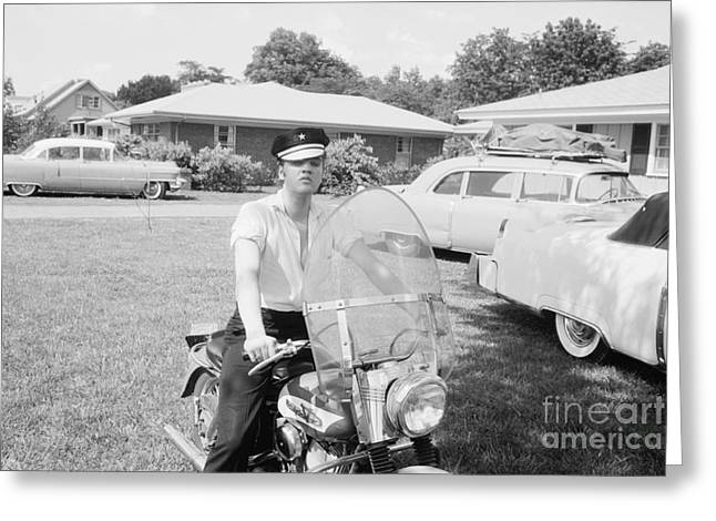 Male Singer Greeting Cards - Elvis Presley sitting on his 1956 Harley KH Greeting Card by The Phillip Harrington Collection