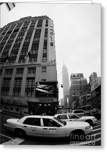 Manhatan Greeting Cards - Empire State Building Shrouded In Mist As Yellow Cabs Crossing Crosswalk On 7th Ave And 34th Street Greeting Card by Joe Fox
