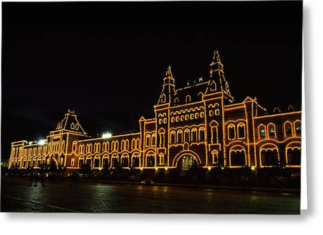 Department Stores Greeting Cards - Facade Of A Building Lit Up At Night Greeting Card by Panoramic Images