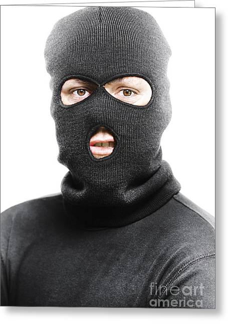 Balaclava Greeting Cards - Face of a burglar wearing a ski mask or balaclava Greeting Card by Ryan Jorgensen