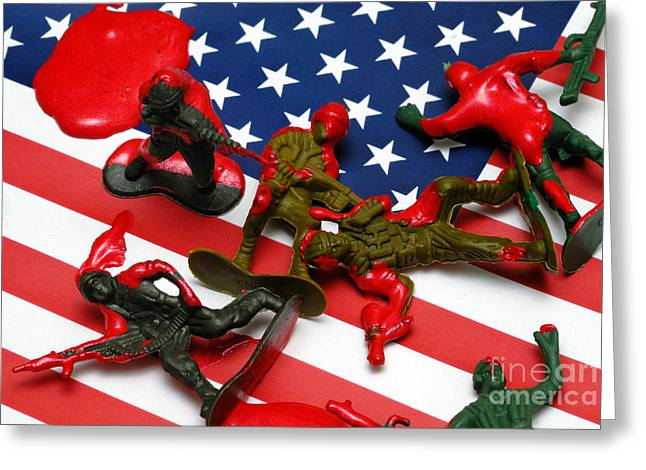 Bloodshed Greeting Cards - Fallen Toy Soliders on American Flag Greeting Card by Amy Cicconi