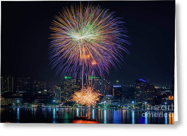 Pyrotechnics Greeting Cards - Fireworks new year celebration at Pattaya beach Greeting Card by Anek Suwannaphoom