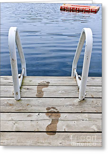 Georgian Bay Greeting Cards - Footprints on dock at summer lake Greeting Card by Elena Elisseeva