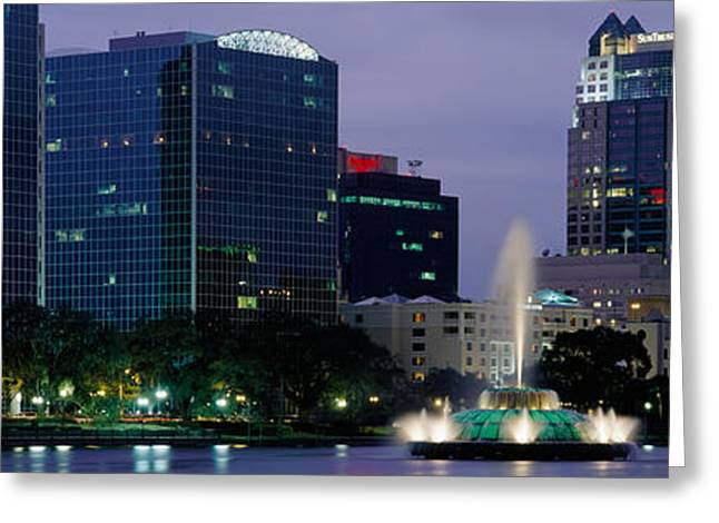 Night Scenes Greeting Cards - Fountain In A Lake Lit Up At Night Greeting Card by Panoramic Images