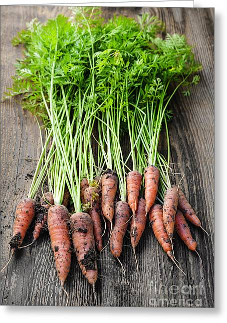 Wooden Table Greeting Cards - Fresh carrots from garden Greeting Card by Elena Elisseeva