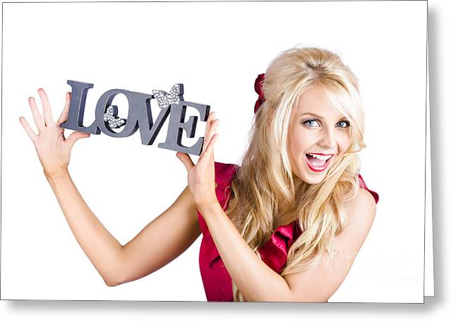 Feeling Youthful Greeting Cards - Fun blonde woman with love word sign Greeting Card by Ryan Jorgensen