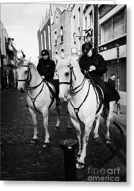 Police Officer Greeting Cards - Garda Siochana Mounted Police On Horseback Taking Notes In Temple Bar Dublin Republic Of Ireland Greeting Card by Joe Fox