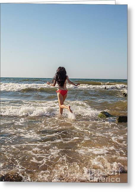 Surf Lifestyle Photographs Greeting Cards - Girl Jumping In Sea Greeting Card by Aleksey Tugolukov