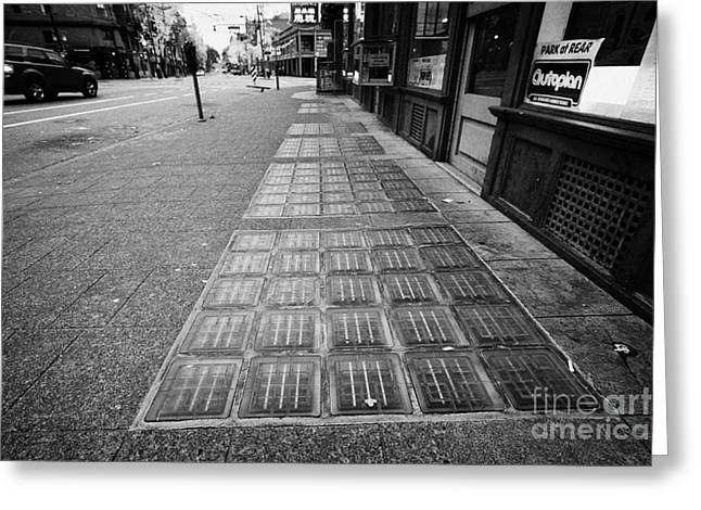 Basement Greeting Cards - glass blocks in the sidewalk to light basement of the sam kee building in Vancouver BC Canada Greeting Card by Joe Fox