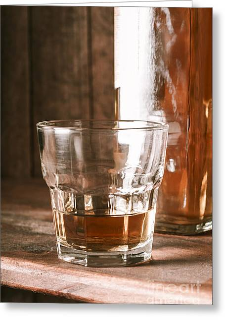 Liquid Gold Greeting Cards - Glass of southern scotch whiskey on wooden table Greeting Card by Ryan Jorgensen