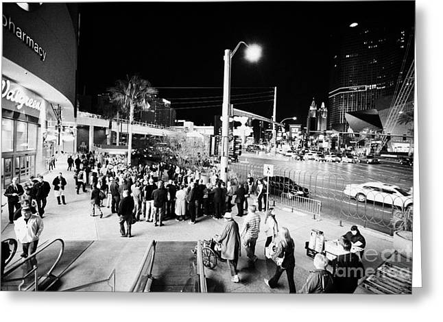 Going Down Greeting Cards - Going Down Escalator To Crowd Around Street Entertainer At Night Las Vegas Boulevard Nevada Usa Greeting Card by Joe Fox