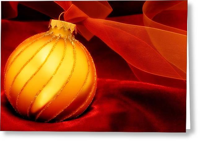 Holiday Decoration Greeting Cards - Golden Ornament with Red Ribbons Greeting Card by Carol Leigh