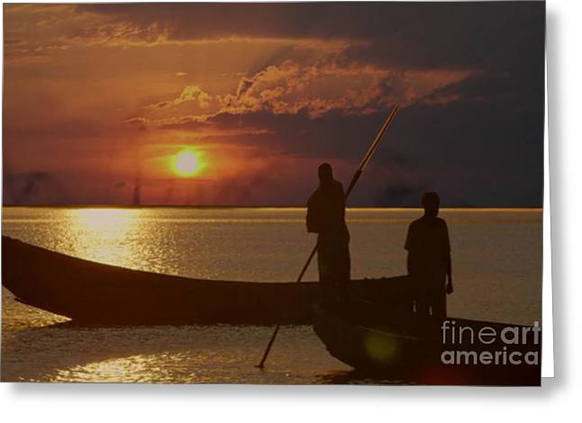 Africa Festival Greeting Cards - Golden sunset two fishermen enjoy the evening after days  hardwork Greeting Card by Navin Joshi