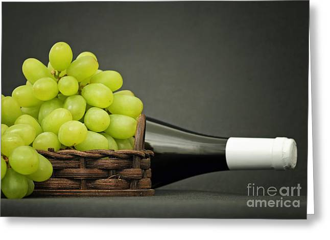 Bunch Of Grapes Greeting Cards - Grapes and a bottle of wine Greeting Card by Skyfish Images