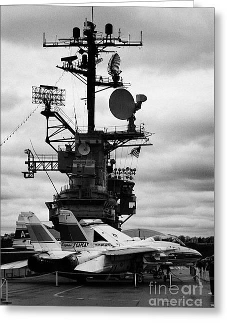 Manhatan Greeting Cards - Grumman F14 in front of the bridge on the flight deck of the USS Intrepid  Greeting Card by Joe Fox