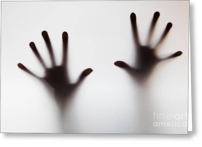 Shout Greeting Cards - Hands touching frosted glass Greeting Card by Michal Bednarek