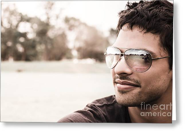 Good Looking Greeting Cards - Handsome Hispanic man relaxing at an outdoor park Greeting Card by Ryan Jorgensen