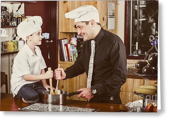 Cooperation Greeting Cards - Happy dad and son baking cake in house kitchen Greeting Card by Ryan Jorgensen