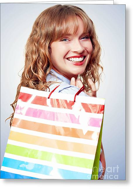 Pastimes Greeting Cards - Happy female retail shopper with bag and smile Greeting Card by Ryan Jorgensen