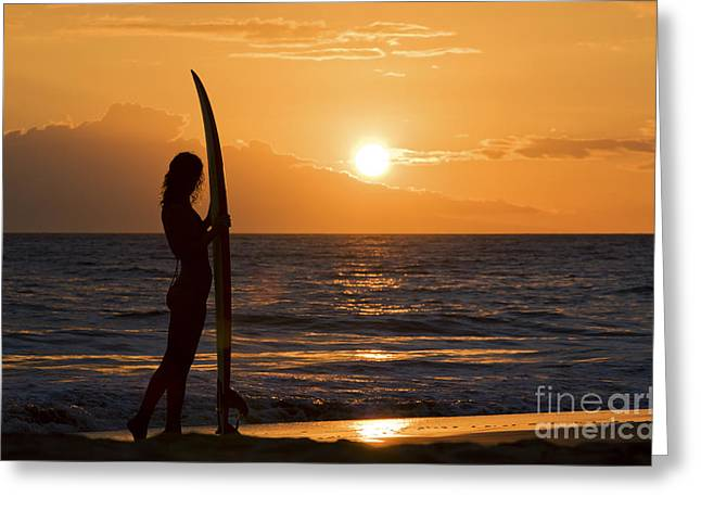 Michael Sweet Greeting Cards - Hawaii, Female Surfer On Beach Silhouetted Against Orange Sunset Over Ocean. Greeting Card by M Swiet Productions
