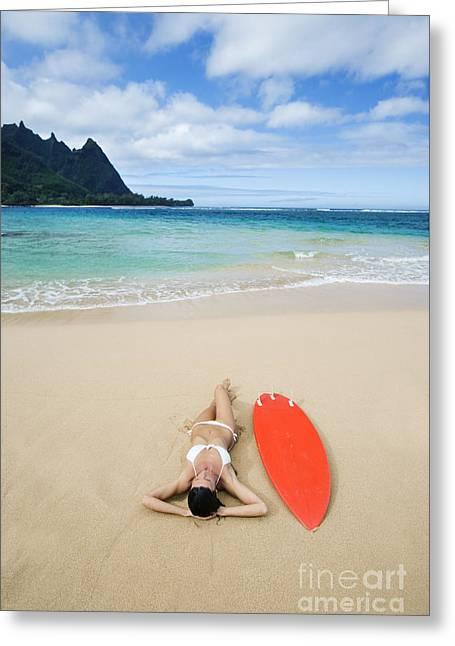 Lay Lady Lay Greeting Cards - Hawaii, Kauai, Haena Beach Tunnels Beach, Woman Laying On Beach With Surfboard. Greeting Card by M Swiet Productions