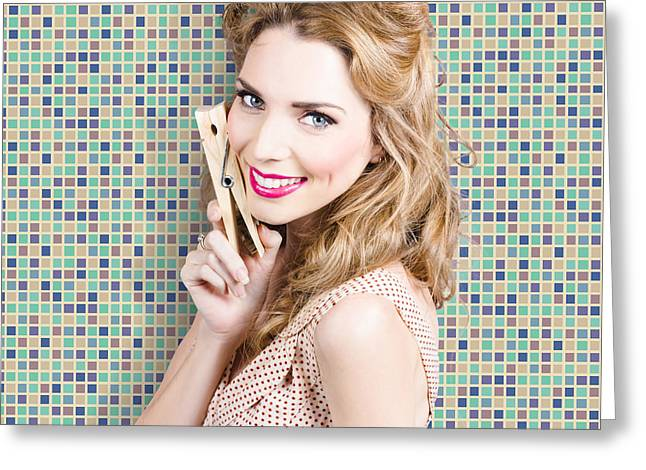 Hair-washing Greeting Cards - Housework. Smiling young woman holding laundry peg Greeting Card by Ryan Jorgensen