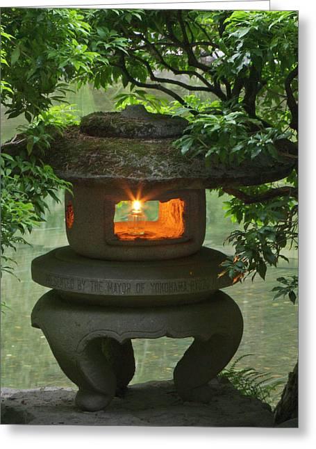 Illuminated Stone  Lantern In Portland Greeting Card by William Sutton