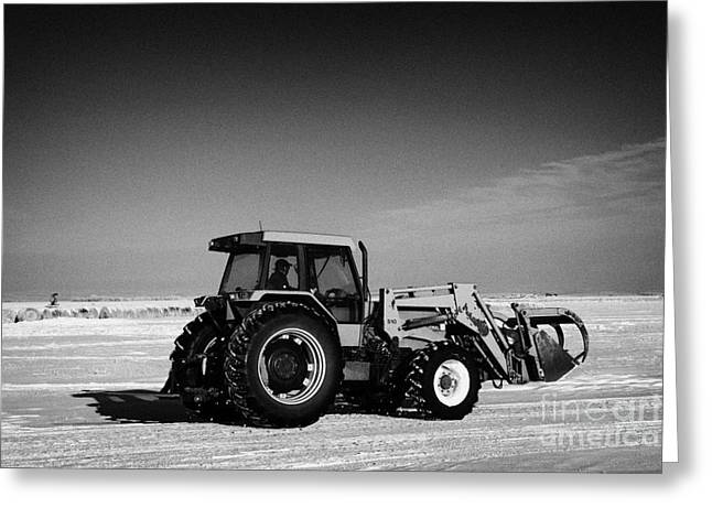 Harsh Conditions Greeting Cards - international 5140 tractor with front end loader on frozen field Forget Saskatchewan Canada Greeting Card by Joe Fox