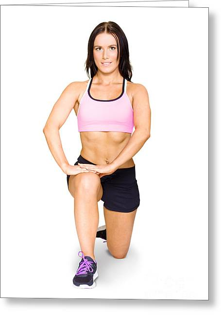 Isolated Female Athlete Stretching Before Exercise Greeting Card by Jorgo Photography - Wall Art Gallery