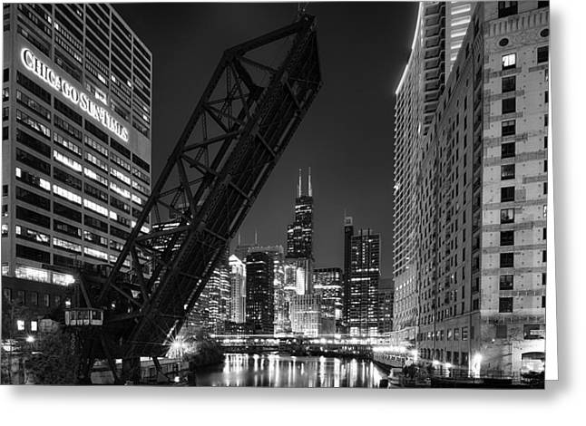Riverfront Greeting Cards - Kinzie Street railroad bridge at night in Black and White Greeting Card by Sebastian Musial