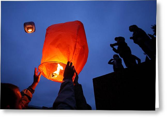 Wishes Greeting Cards - Launching wish lanterns Greeting Card by Science Photo Library