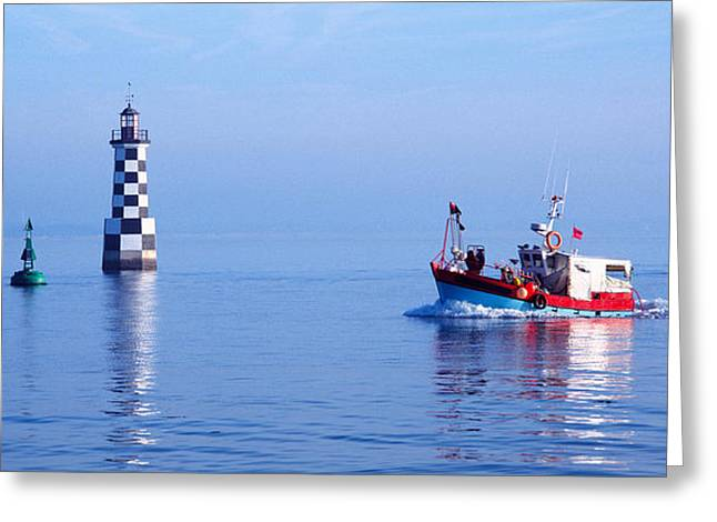 Fishing Boats Greeting Cards - Les Perdrix Lighthouse And Fishing Boat Greeting Card by Panoramic Images