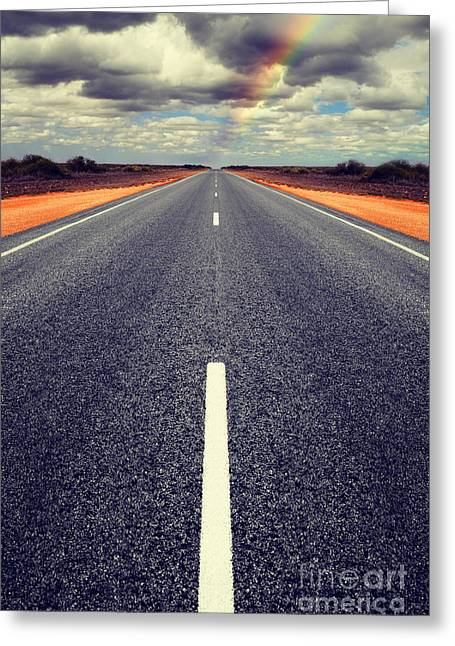 Road Greeting Cards - Long Straight Road with Gathering Storm Clouds Greeting Card by Colin and Linda McKie