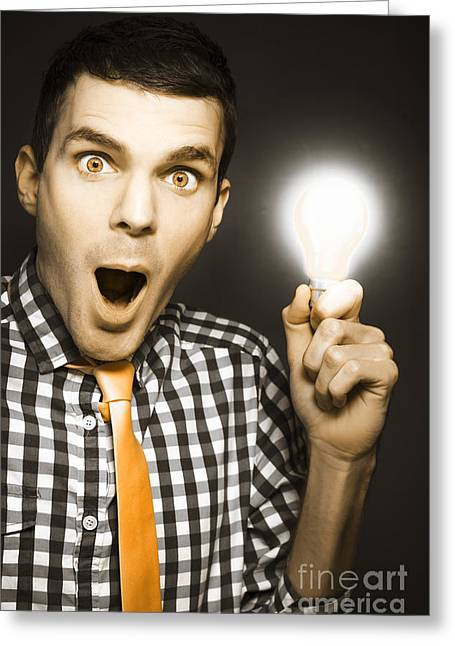 Satisfaction Greeting Cards - Male Business Person With Light Bulb In Hand Greeting Card by Ryan Jorgensen