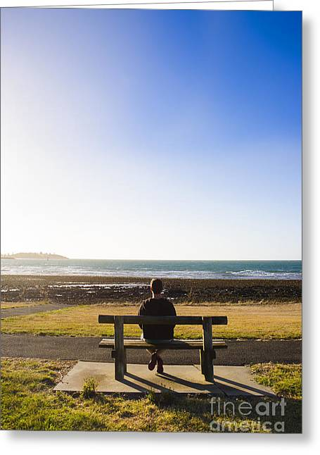 Peaceful Scenery Greeting Cards - Male tourist enjoying ocean landscape sunset Greeting Card by Ryan Jorgensen