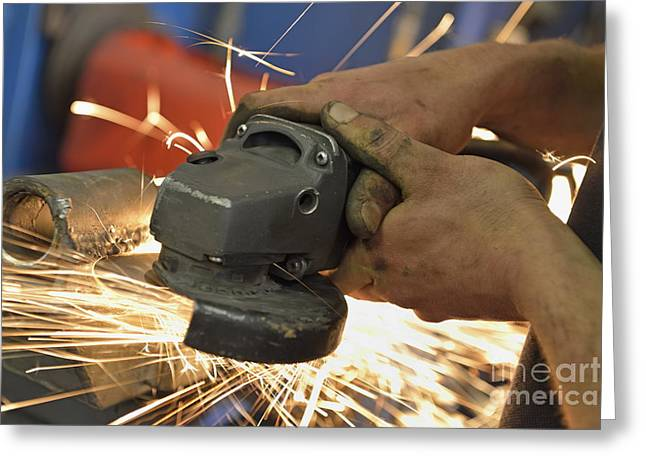 Man Cutting Steel With Grinder Greeting Card by Sami Sarkis