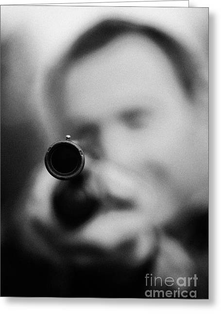 Man In Camouflage Clothes Takes Aim At Camera With Shotgun Close Up  On December Shooting Day Greeting Card by Joe Fox