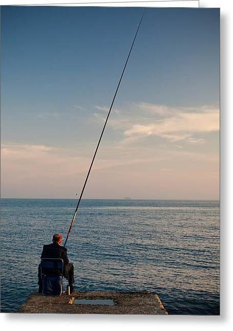 One Man Only Greeting Cards - Man Pier Fishing, Lighthouse Beach Greeting Card by Panoramic Images