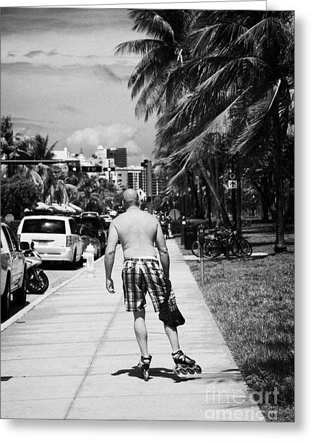Oceanview Greeting Cards - Man Rollerblading Along Ocean Drive Early Morning Art Deco District Miami South Beach Florida Usa Greeting Card by Joe Fox
