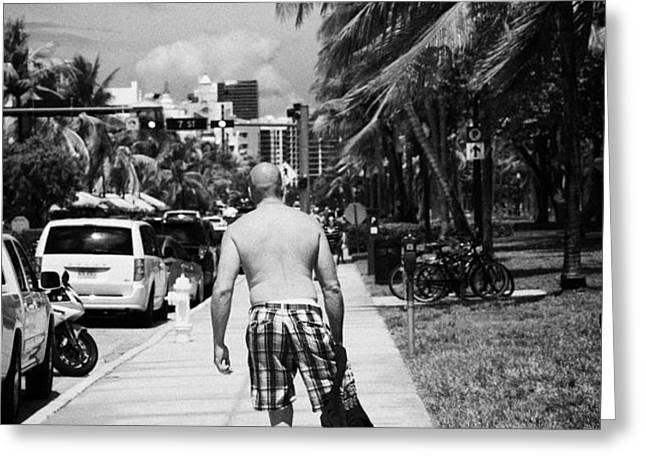 man rollerblading along ocean drive early morning art deco district miami south beach florida usa Greeting Card by Joe Fox