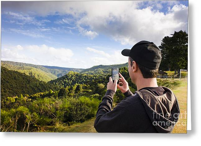 Taking Photographs Greeting Cards - Man taking mountain photo of Tarkine reserve Greeting Card by Ryan Jorgensen